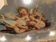 Фотопечать на натяжном потолке изображения ангелов, резвящихся в небе с авторской обработкой