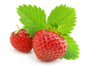 red strawberry fruits with green leafs isolated on white background